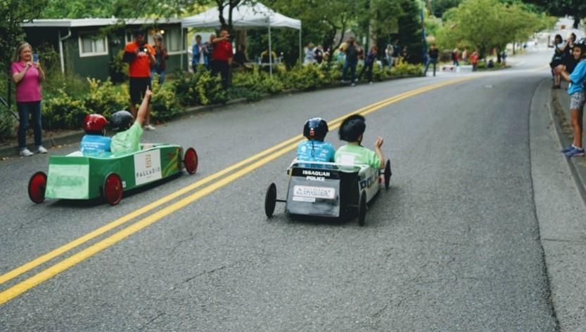 Children in soapbox derby racers
